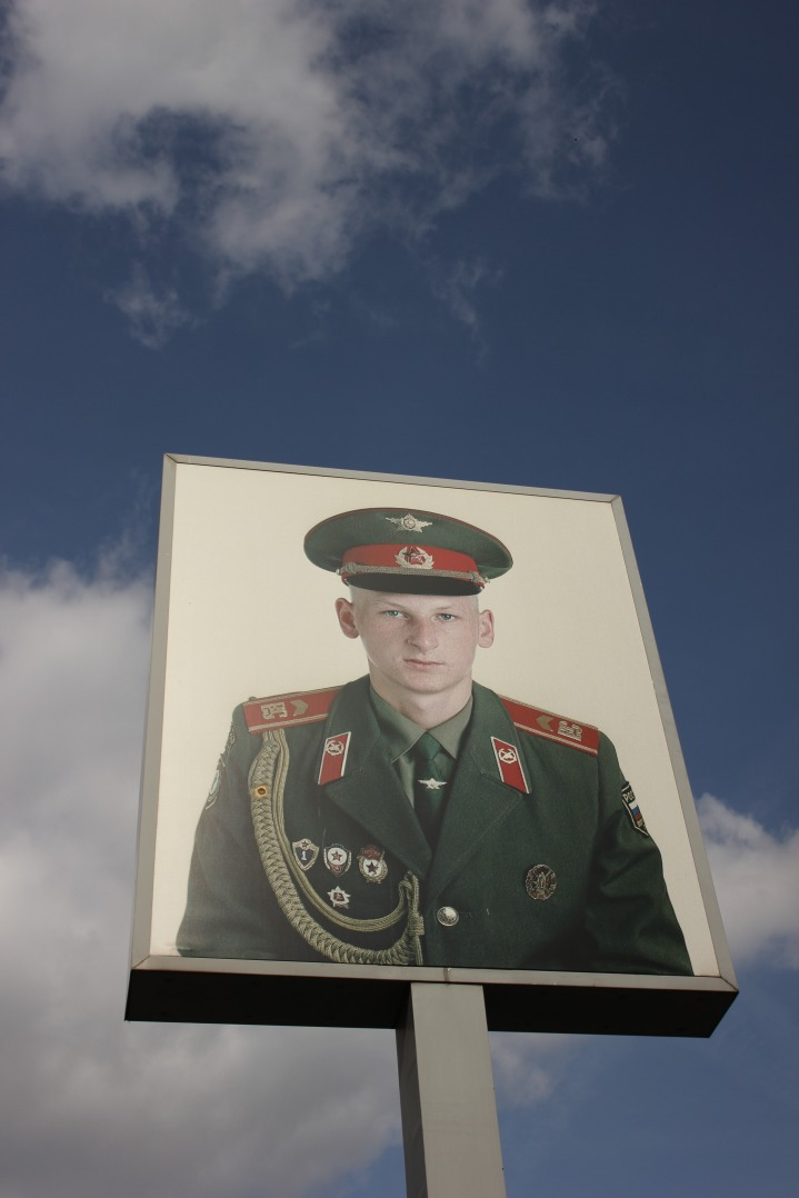 A picture of a Soviet soldier in the sky above Checkpoint Charlie, Berlin Wall, Berlin.